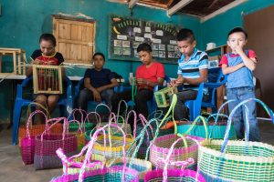 These children are learning a marketable skill -- making beautiful baskets!